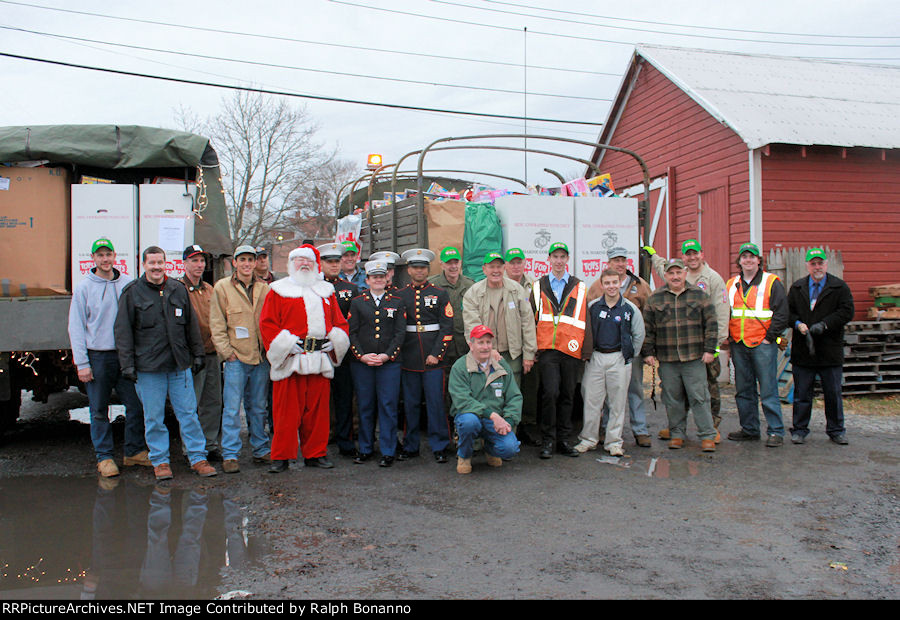 Group picture of the bulk of the volunteers, plus Santa, the Marines, and M&NJ personnel