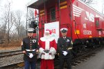 Santa and the service Reps(USMC, left, US Navy,right) pose at the first stop of the day