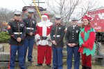 Stars of the weekend: the USMC reps, Santa and his elf