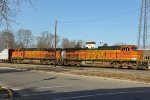 BNSF 4127 leads a Eb freight into town.