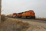 BNSF 7373 hurries a WB stack train.