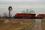 BNSF 7239 heads Wb past this old windmill.