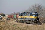 ICE #6411 Passes a NE Iowa Farm as it heads Eastbound