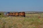 BNSF ES44C4 6642 and 4 friends lead an endless stack train toward Miami, TX.