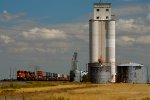 BNSF 6991 (ES44C4) passes a grain elevator in White Deer, TX.