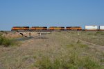 BNSF ES44DC 7201 leads three other units across US 60 near Fort Sumner, NM