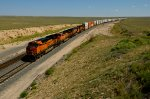 BNSF ES44DC 7221 leads an endless stack train west near Encino, NM.