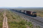 UP AC45CCTE 7652 pushes on the rear of an eastbound UP freight at Akela, NM