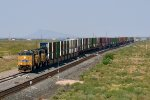 UP 7874 (AC45CCTE) gallops through Akela, NM with an eastbound stack train.