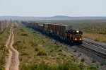 UP 4329 (SD70M) on a westbound passes an eastbound near Akela, NM.