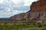 BNSF 7394 (ES44DC) rolls past the red rocks at Mesita, NM.