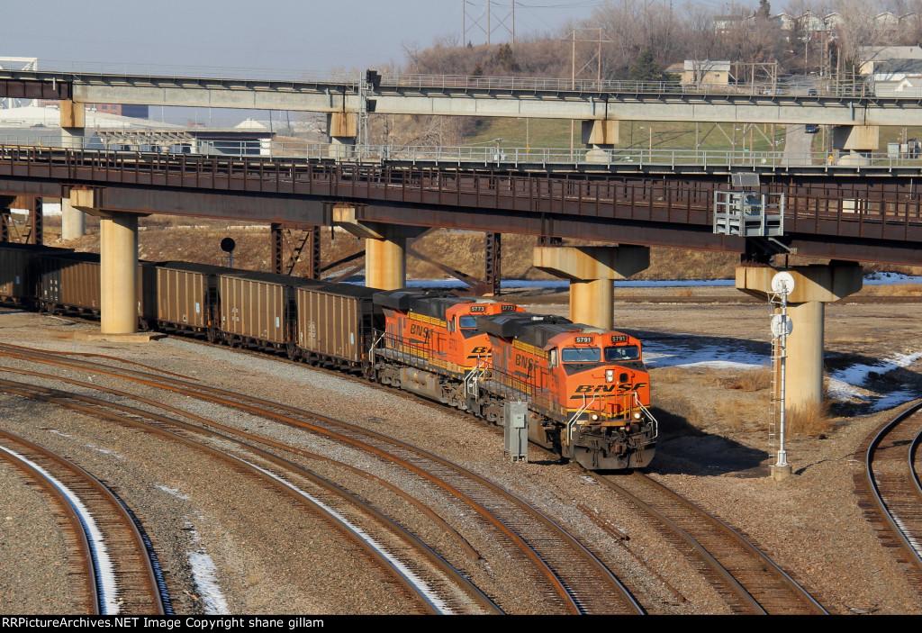 BNSF 5791 works a coal load Sb.