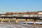 BNSF 7841 heads A stack train Wb.