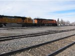 BNSF ES44AC 5980 and SD70MAC 8917 move a freight past the station area