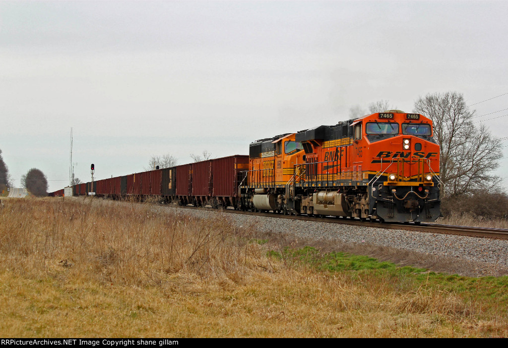 BNSF 7465 Takes a load of ore Sb.
