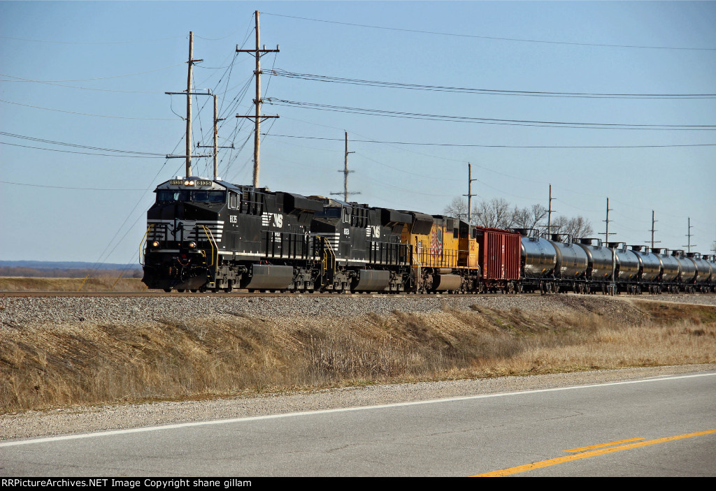 NS 8135 Leads a empty oil train Nb with up power 3rd out.