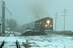 BNSF 4875 leads a freight into the Snow storm.