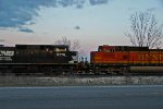 NS 9776 and bnsf 5231 trail on a Nb freight train.