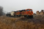 BNSF 7568 heads SB with a loaded Oil train.