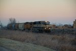 BNSF 9820 Is seen being passed bye a empty coal train.
