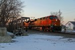BNSF 6299 Leads a empty coal train Into town.