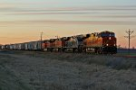 BNSF 6621 Heads out of the Evening light.