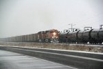 BNSF 5917 Heads into the snow With a Coal load.