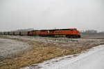 BNSF 5787 leads a Empty coal into the snow.
