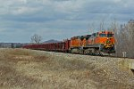BNSF 1007 Takes a loaded rail train Sb.