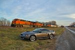BNSF 7025 Leads a Nb mixed freight Into the Evening Sun.