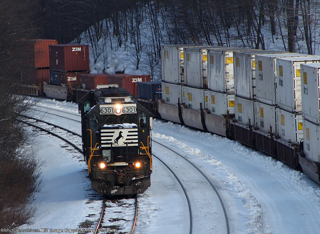 Helpers pass an eastbound stack train at Mile 255 Pittsburgh Line