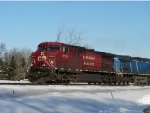 CP 9634 with no emblem leads a blue one on 499 westbound