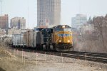 UP 4115 and a CEFX AC4400CW leave downtown behind with CP train 280 eastbound