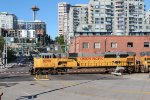 UP 8299, 8266, 8293 pull a CP Grain train through down town Seattle