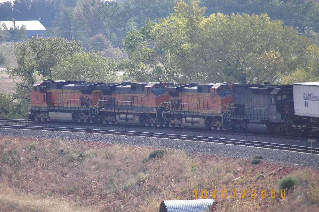 BNSF C44-9W 4948, BNSF C44-9W 994, BNSF C44-9W 4986 and NREX, ex SP, SD40T-2 8543