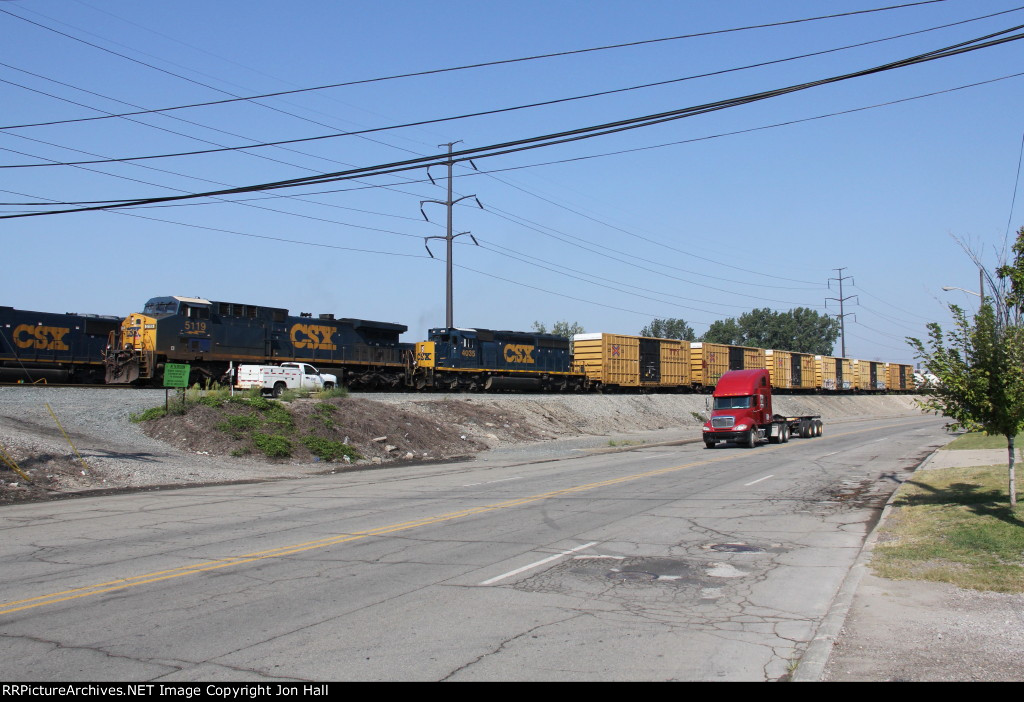 CSX 5119 & 4035 sit along Industrial St as they wait to proceed toward Delray with Y122