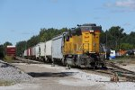 2668 pulls back after seperating the grain cars from the chemical cars