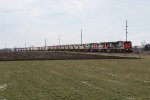 CN 2104 leads M396 east with a massive 14 unit consist including 10 brand new QNS&L units