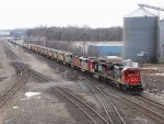 Entering Battle Creek Yard at Emmett St, CN 2104 leads 13 more units as M396 heads toward a crew change at the east end
