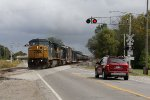Crossing Griswold Ave, CSX's D710 starts west for Flint on CN's Flint Sub