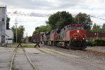 CN 2628 charges east through Imlay City leading M396