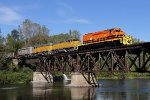 With bright fresh paint, 3389 leads Z151 over the Muskegon River under a crystal blue sky