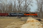 BNSF 9218 Heads Sb across a empty field.