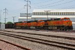 BNSF 5839 and others sit tied down on a ore train.