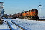 BNSF 4524 Slows to 25mph for a slow order.