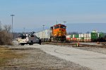 BNSF 4018 sits on a triple crown train.