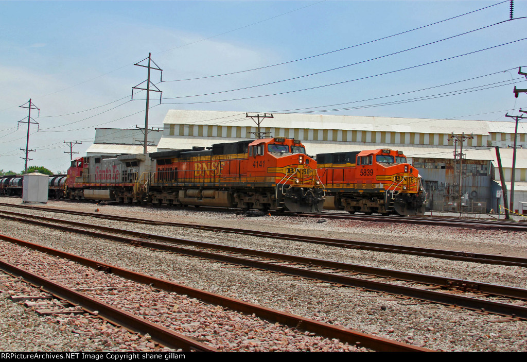 BNSF 4141 Leads the MADGAL NB past a ore train!!