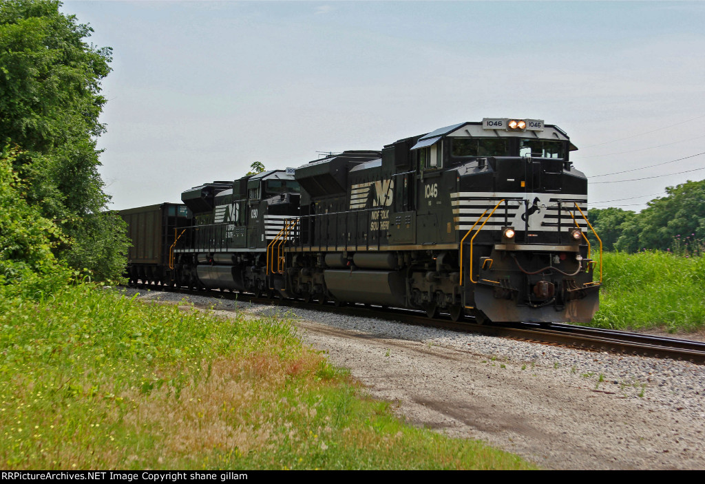 NS 1046 Leads a empty coal train back Nb.