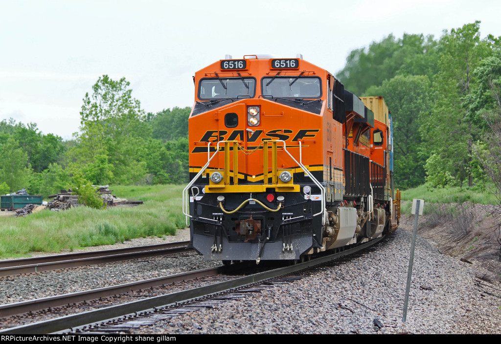 BNSF 6516 More C4's work a Wb stack train.