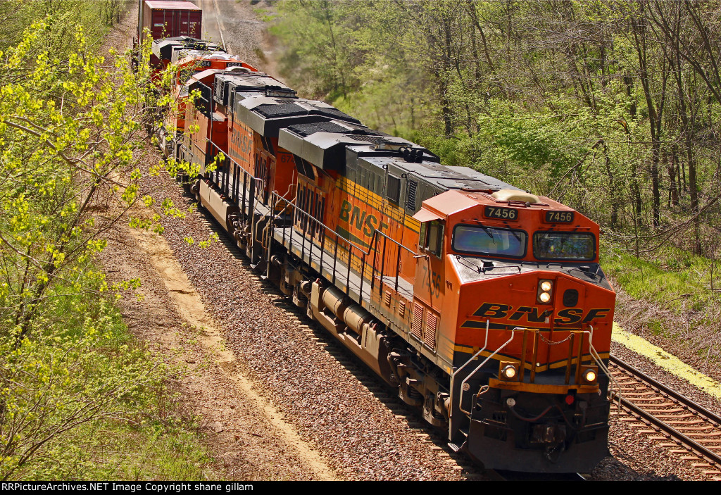 BNSF 7456 Slows for a red Signal.